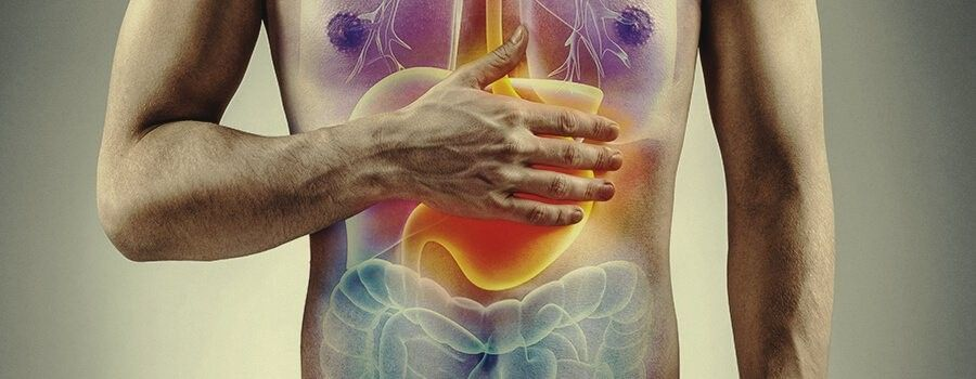 Image of man holding hand over stomach